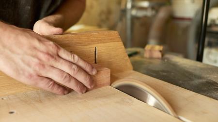 Photo pour Cutting the blanks on the tailblock. Lautner makes a classic guitar. - image libre de droit