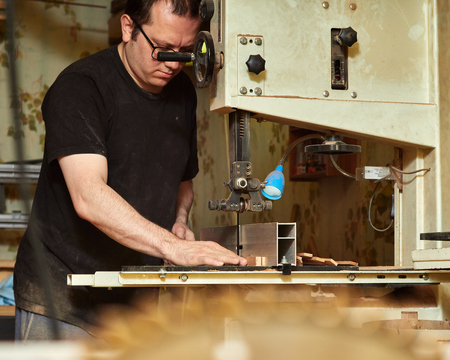 Lautner makes a classic guitar. Cutting of blanks for linings.