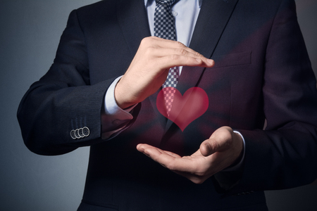 Photo pour businessman hands closeup. a man in business suit shows caring gesture. life and health insurance. - image libre de droit