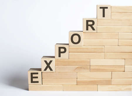 Photo pour EXPORT Word Written In Wooden Blocks on the white background - image libre de droit