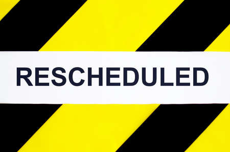 Photo pour Rescheduled text on tape black and yellow background - image libre de droit