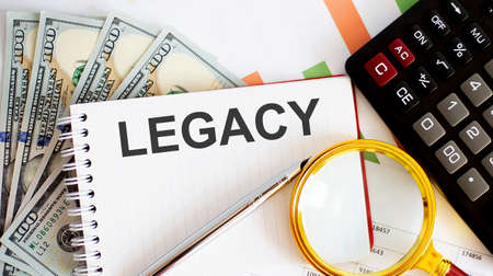Photo pour Word text LEGACY. Business concept with chart, dollars and office tools - image libre de droit