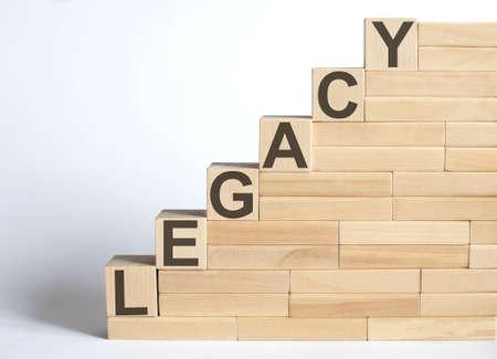 Photo pour Work strategy on the wood blocks LEGACY on white background - image libre de droit