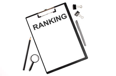 Photo for On a white background magnifier, a pen and a sheet of paper with the text RANKING. Business - Royalty Free Image