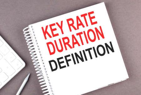 Photo pour KEY RATE DURATION DEFINITION text on notebook with calculator and pen, business concept - image libre de droit