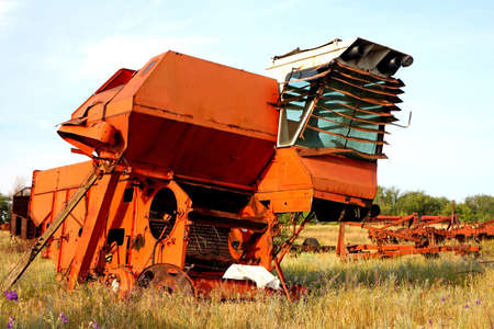 Old rusty abandoned spoiled combine harvester