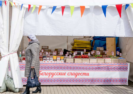 Russia, Vladivostok, 03/23/2020. Shopping pavilion with candies and chocolates on the street. Street trading and inexpensive market. Trading and shopping.