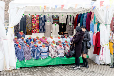 Russia, Vladivostok, 03/23/2020. Shopping pavilion with inexpensive casual clothes on the street. Street trading and inexpensive market. Trading and shopping.