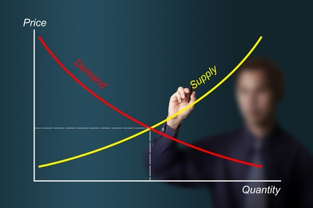 business man drawing economic demand supply graph