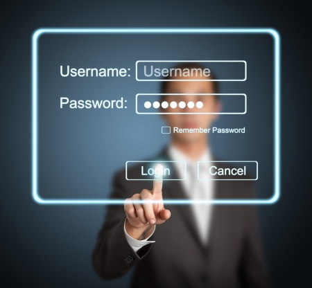 businessman pressing login button on internet sign in page on computer screen