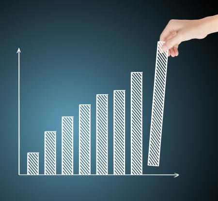 business hand building upward trend financial graph