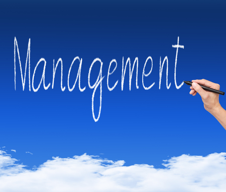 business hand writing management cloud text on blue sky