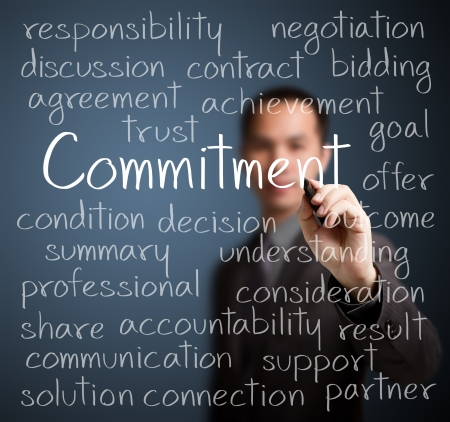 business man writing commitment concept