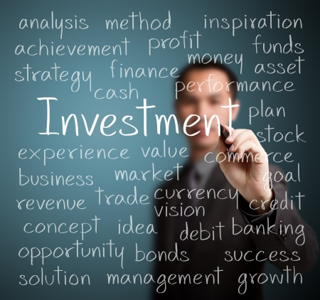 business man writing investment concept