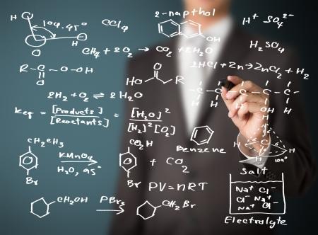 Photo pour chemistry teacher writing science and chemical formula - image libre de droit