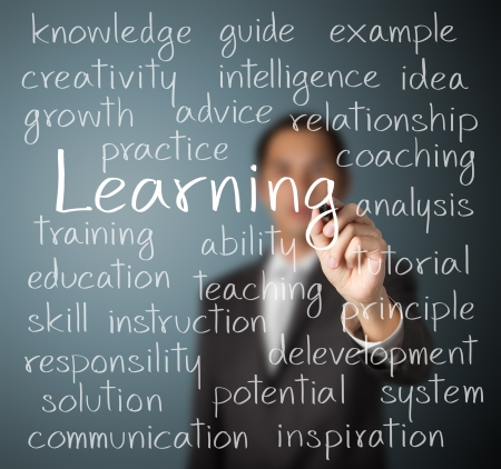 business man writing learning concept