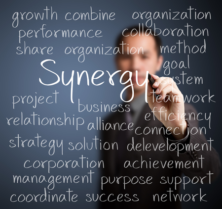 business man writing synergy concept
