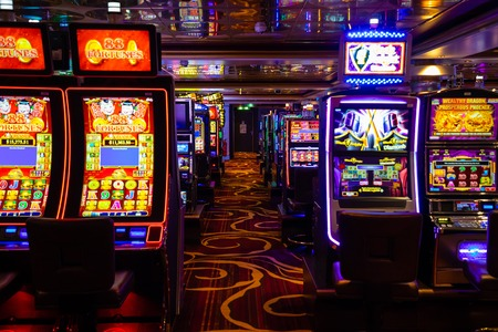 Venice, Italy - 14.10.2018: Modern empty casino hall with game machines in cruise ship Norwegian Star, Italy