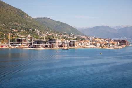 View of construction site of luxury buildings in town in Bay of Kotor in Montenegro