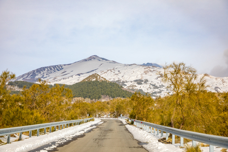 Photo for Road to volcano and snow covered Etna Mount, Sicily in Italy - Royalty Free Image
