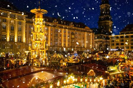 Photo for Dresden, Germany - 9.12.2018: People visit Christmas Market Striezelmarkt in Dresden in Germany - Royalty Free Image