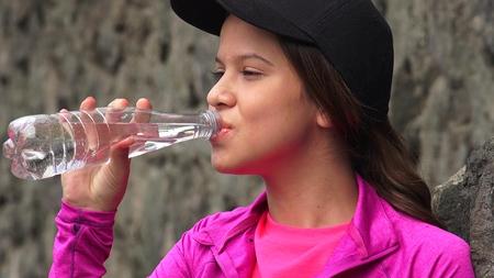 Female Teen Drinking Bottled Water
