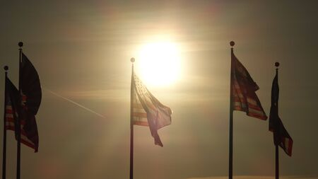 Us Flags At Dusk