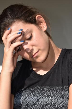 Youthful Girl And Sadness