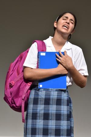 Confused Female Student Wearing School Uniform