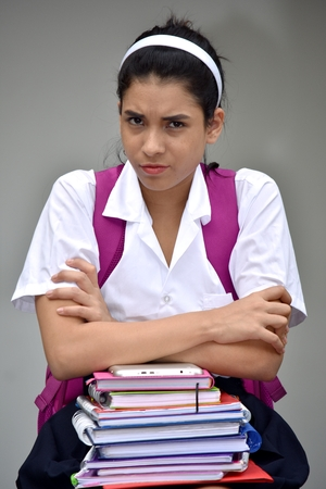 Cute Female Student And Anger Wearing Uniform With Textbooks