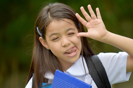 Diverse Girl Student Making Funny Faces Wearing School Uniform With Notebooks