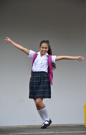 Photo pour Catholic Girl Student Standing Wearing Uniform - image libre de droit