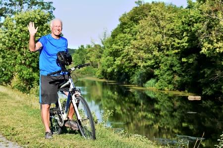 Friendly Adult Male Athlete Wearing Helmet Cycling