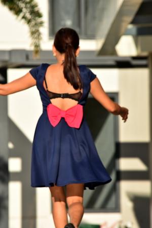 Female With Ponytail Wearing Dress Walking