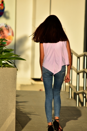 Asian Female With Long Hair Walking