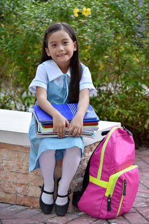 Photo for Cute Girl Student Smiling Wearing Uniform - Royalty Free Image