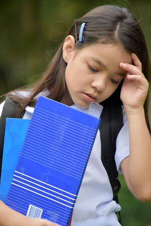 Sad School Girl Wearing School Uniform With Notebooks