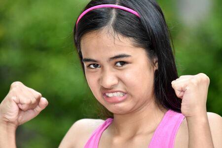 A Youthful Filipina Female And Anger