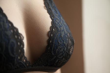 Foto de Beautiful big female breasts in a bra, sexy boobs. Advertisement of a lingerie. - Imagen libre de derechos