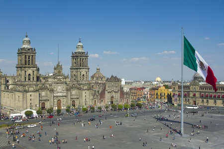 the zocalo in mexico city, with the cathedral and giant flag in the centre