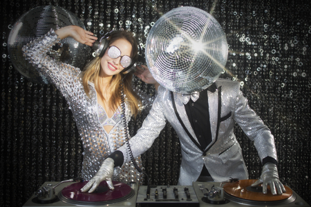 introducing mr and mrs discoball. two cool club characters DJing in a club
