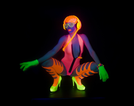 Photo for sexy female disco dancer poses in UV costume - Royalty Free Image