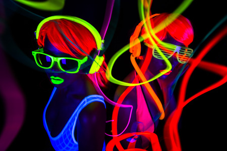 Photo for two sexy female disco dancers posing in UV costume - Royalty Free Image