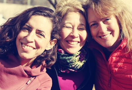 Photo for Portrait of three mature beautiful women outside - Royalty Free Image