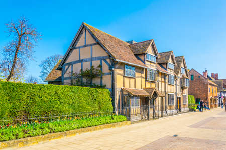 Photo for People are strolling next to the birth house of William Shakespeare in Stratford upon Avon, England  - Royalty Free Image