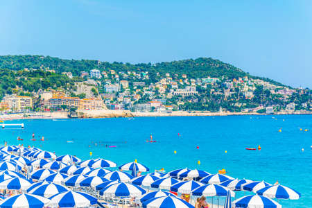 Photo for NICE, FRANCE, JUNE 11, 2017: People are enjoying summer on a beach in Nice, France - Royalty Free Image