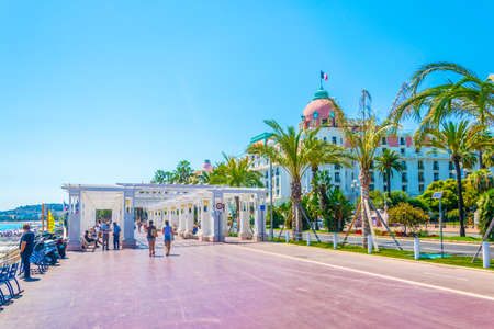 Photo for NICE, FRANCE, JUNE 11, 2017: People are strolling on promenade des anglais in Nice, France - Royalty Free Image