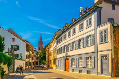 Foto de People are coming from the münster church in the old town of Basel, Switzerland - Imagen libre de derechos