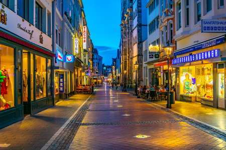 Photo for BONN, GERMANY, AUGUST 12, 2018: Night view of a narrow street in the center of Bonn in Germany - Royalty Free Image