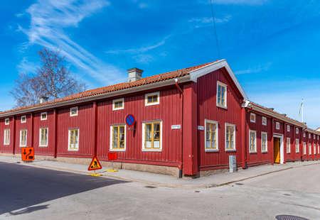 Photo pour Timber houses alongside a narrow street at Nora, Sweden - image libre de droit